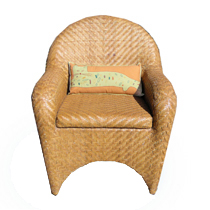 Kitty Planet embroidered pillow in a chair